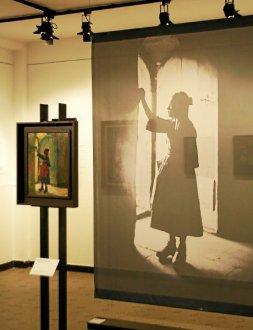 Le double regard entre photographies et oeuvres peintes est 3885730 253x330p